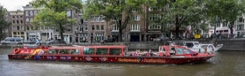Varen met de hop-on hop-off cruise door Amsterdam