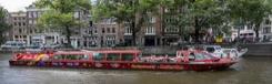 Varen met de hop-on hop-off cruise door Amsterdam